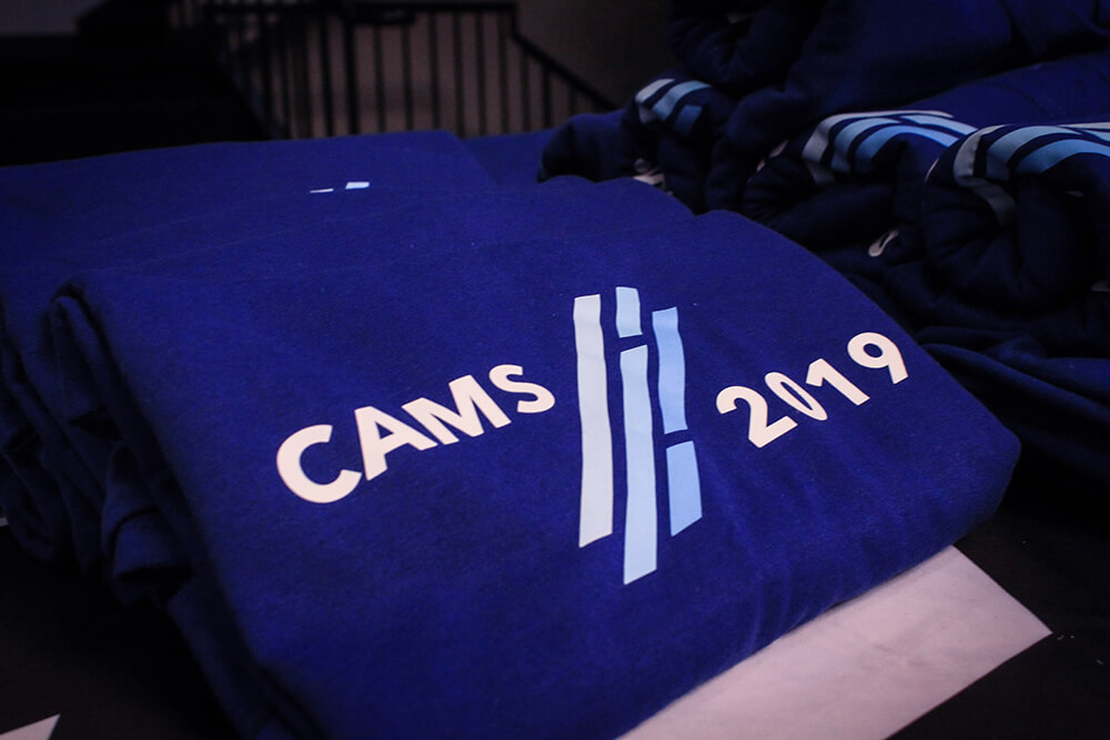 Cams shirts folded on table